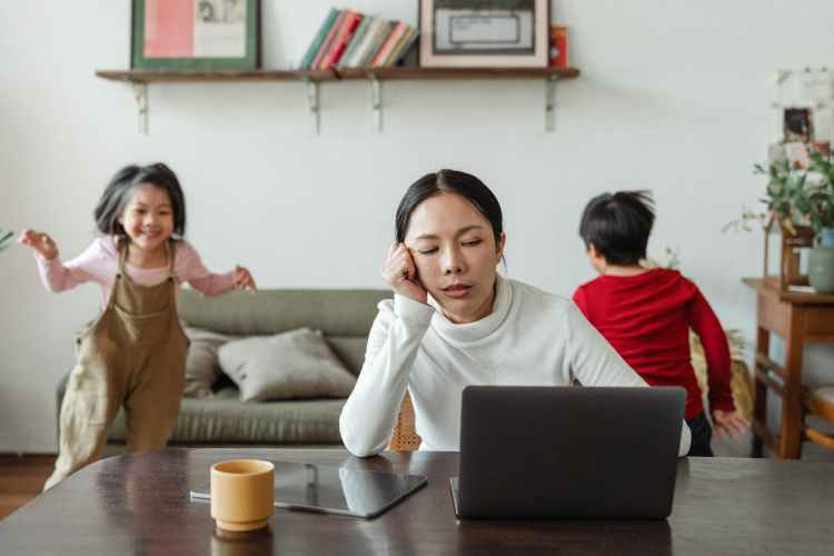 kids making noise and disturbing mom working at home