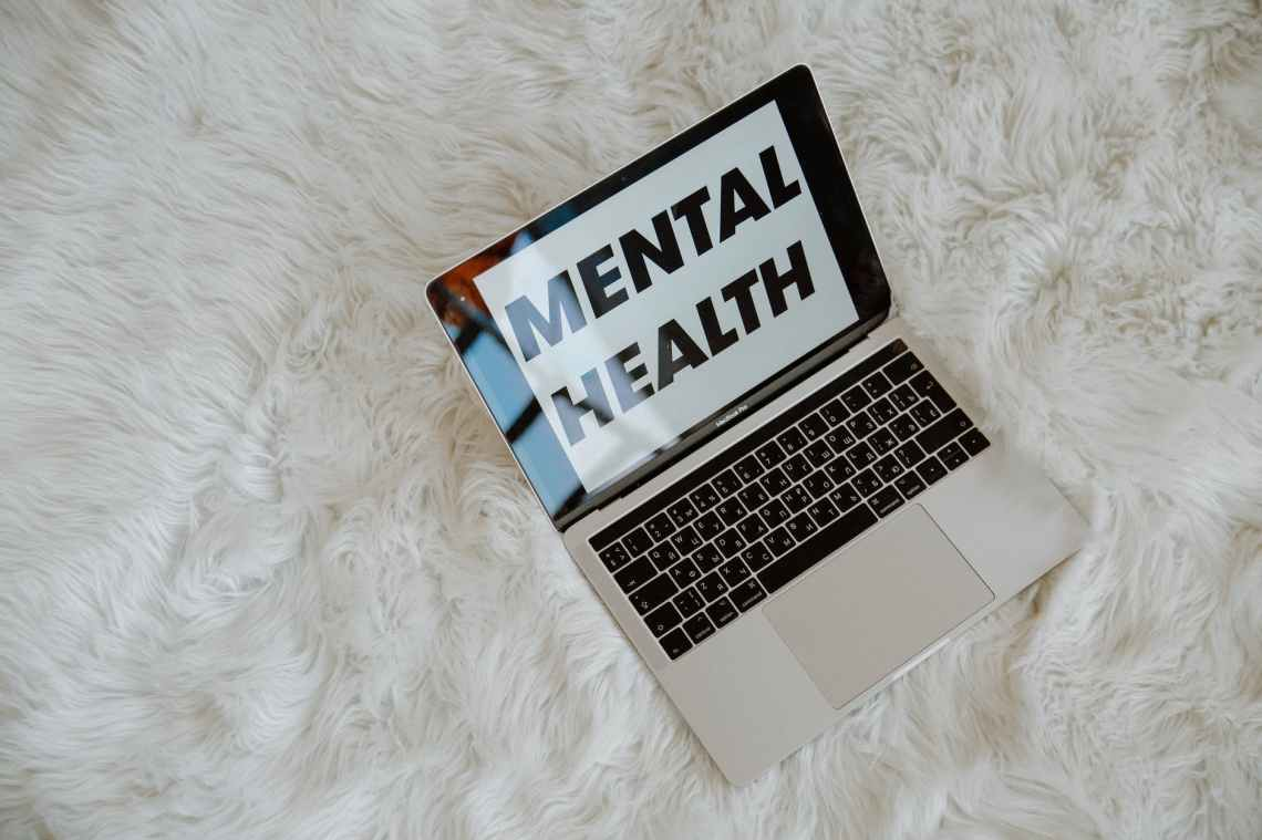 laptop screen with the words MENTAL HEALTH mental healthcare