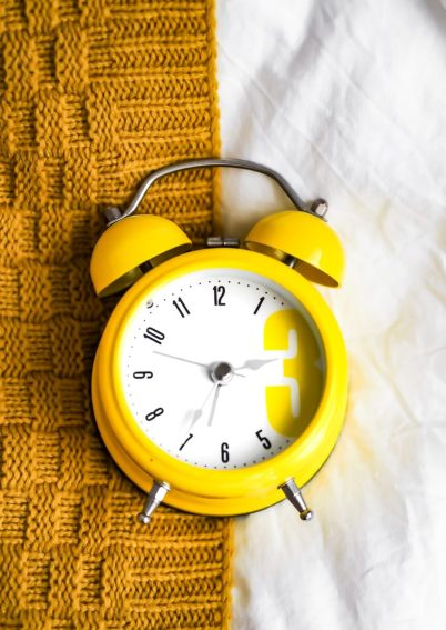yellow and white alarm clock at 10 10 routine