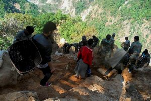 Kathmandu: Indian Army, along with locals, clear the 8-km track from Valuwa to Mandhra, blocked in the recent earthquake, in Kathmandu, Nepal. PTI Photo