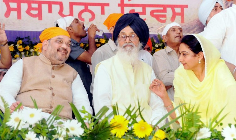 BJP President Amit Shah, Punjab Chief Minister Parkash Singh Badal and Union Minister for Food Processing & Industry Harsimrat Kaur Badal during a function to mark 350th foundation day of Sri Anandpur Sahib on Friday. PTI Photo.