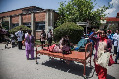 Recent evacuees from the wards of the Teaching hospital in Kathmandu lie in the open after being evacuated immediately after the second big earthquake hit Nepal on May 12. Credit: Vivek Singh