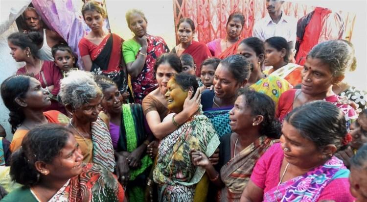Family members of illicit liquor victims at the slum area of Malvani in Mumbai on Saturday. PTI Photo by Santosh Hirlekar