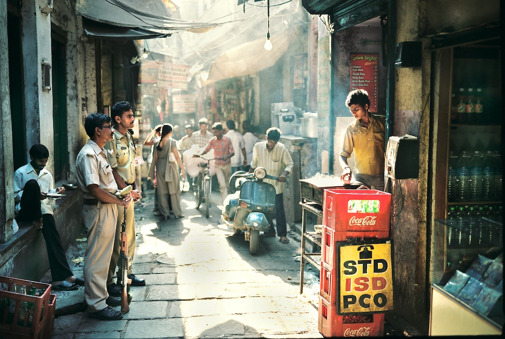 MADE TO ORDER: Policemen in Varanasi watch as a boy makes dosas. Credit: Lyle Vincent/Flickr CC 2.0