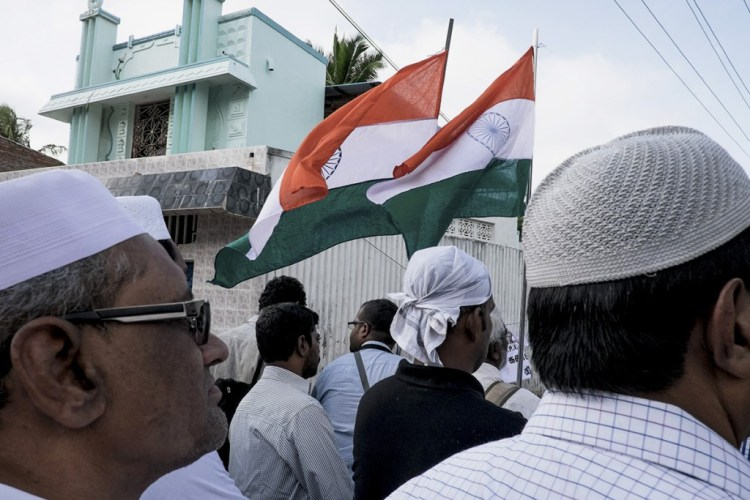 'Vande Mataram' and many patriotic slogans are blared and the Indian flag is hoisted outside the mosque as the people await the arrive of Kalam's body for the final rites. © Shuchi Kapoor