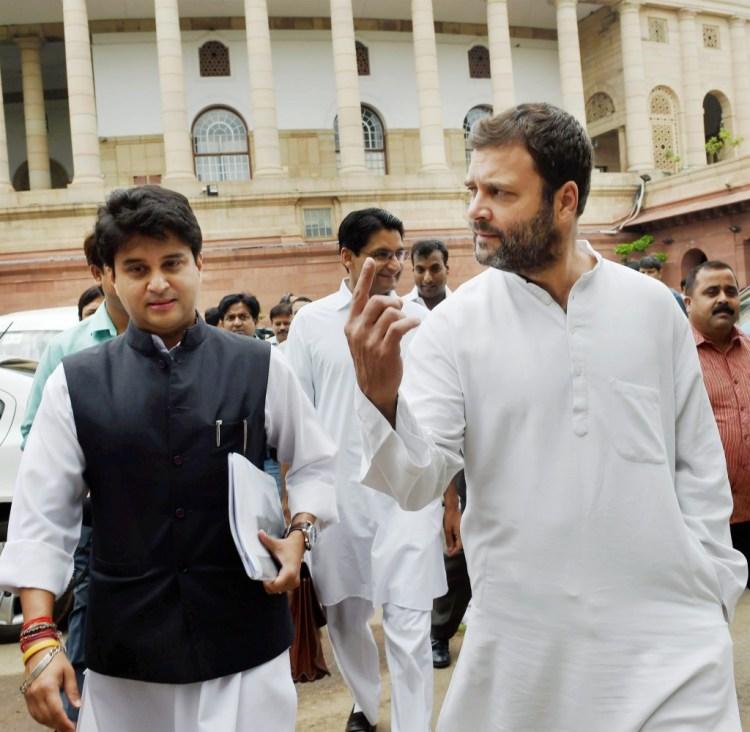 Congress Vice President Rahul Gandhi with party MP Jyotiraditya Scindia at Parliament House during the Monsoon session. Credit: PTI Photo by Subhav Shukla