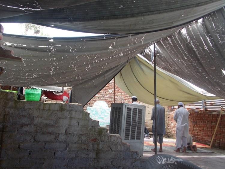 Residents offering namaaz at the makeshift mosque on Sunday afternoon. Credit: Photo: Sangeeta Barooah Pisharoty