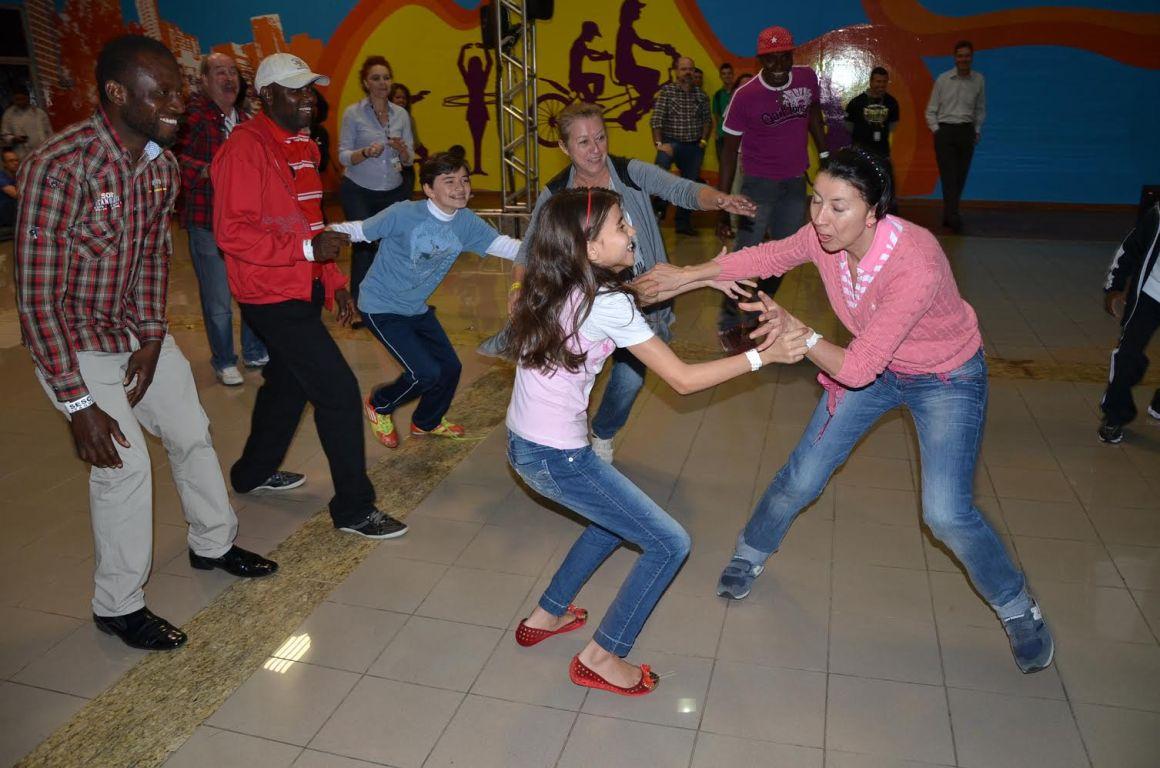 Refugees celebrating World Refugee Day in Sao Paulo, dancing to samba music. Source: ACNUR Brasil
