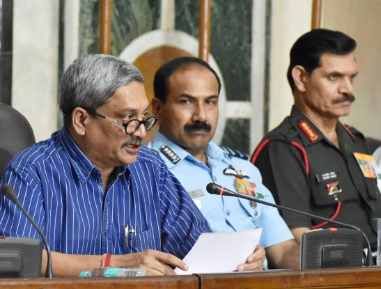 Defence Minister Manohar Parrikar with Air Chief Marshal Arup Raha and Army chief General Dalbir Singh Suhag at a press conference to announce implementation of One Rank One Pension (OROP) scheme at South Block in New Delhi on Saturday. PTI Credit: Photo by Atul Yadav