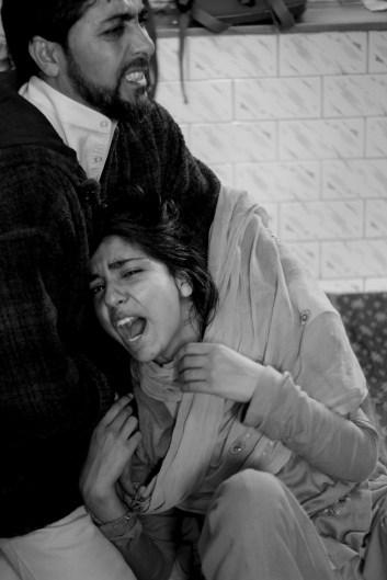 Nahyeeda Kayoom mourns the death of her 17-year-old brother Omer Kayoom Bhat in Srinagar. Credit: Shome Basu
