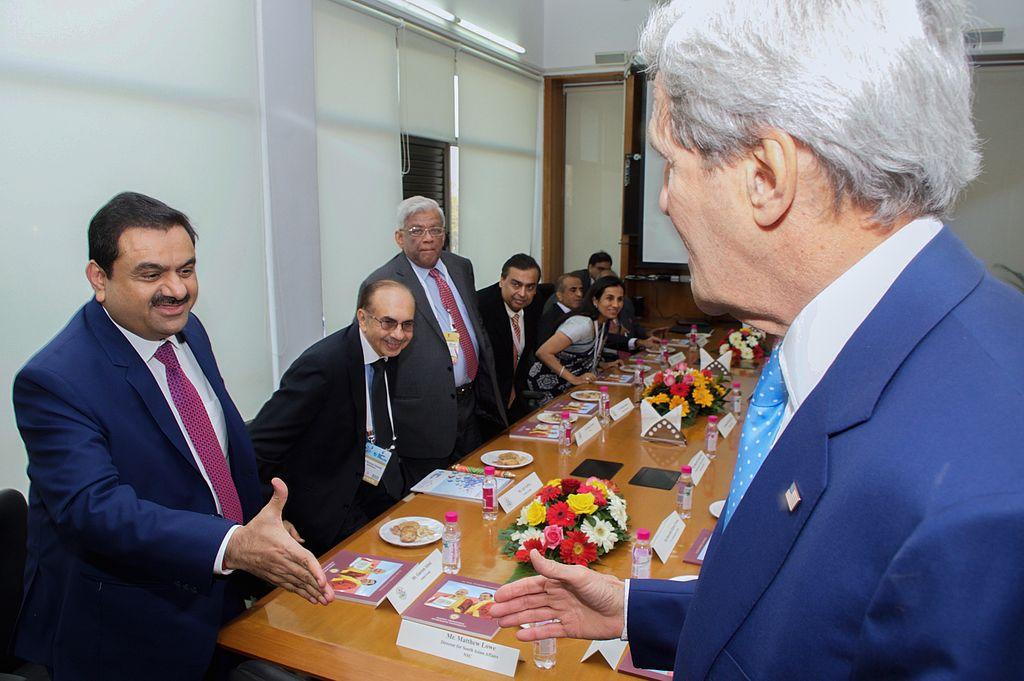 Gautam Adani greets Secretary of State John Kerry on the sidelines of the Vibrant Gujarat Summit in Gandhinagar. [State Department photo/ Public Domain]