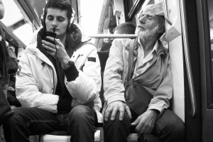 An older man intrigued by his younger passenger's phone, in Paris. Credit: hugobernard/Flickr, CC BY 2.0