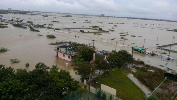 The neighbourhood of PSB College on Old Mahabalipuram Road is fully inundated following two days of cyclonic rains in Chennai. The important road is visible as a thin white line barely above the water. Credit: Jo Prasanth