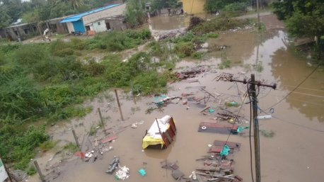 The houses of a slum in Kelambakkam are fully underwater following heavy rains in Chennai for two days. Credit: Vijay Thamarai