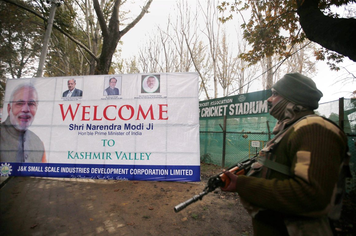 A Central Reserve Police Force (CRPF ) jawan stands guard outside the venue of Prime Minister Narendra Modi's forthcoming rally outside the Sher-e-Kashmir Stadium in Srinagar on Thursday. Credit: PTI