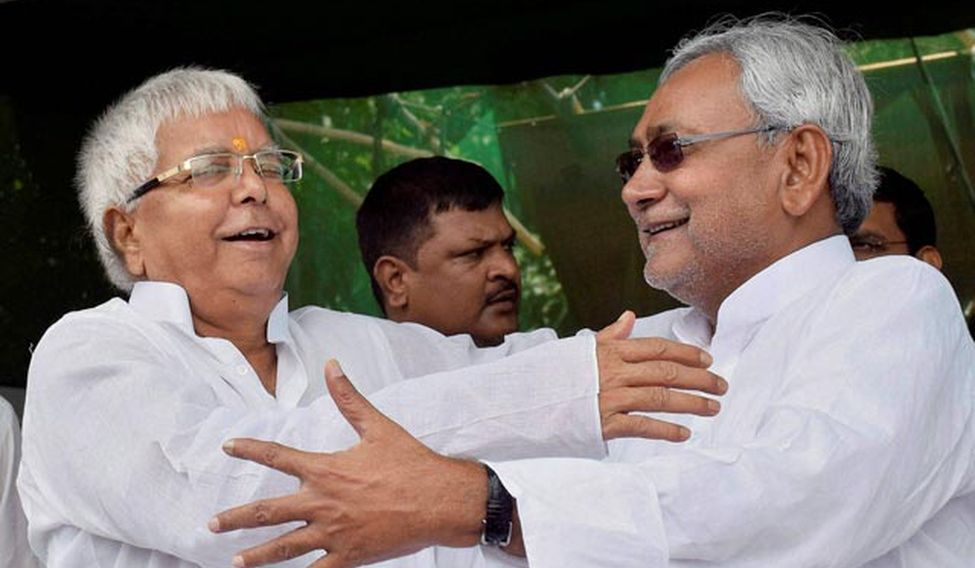 Lalu Yadav and Nitish Kumar after their impressive victory in the Bihar Assembly elections. (Photo: PTI)