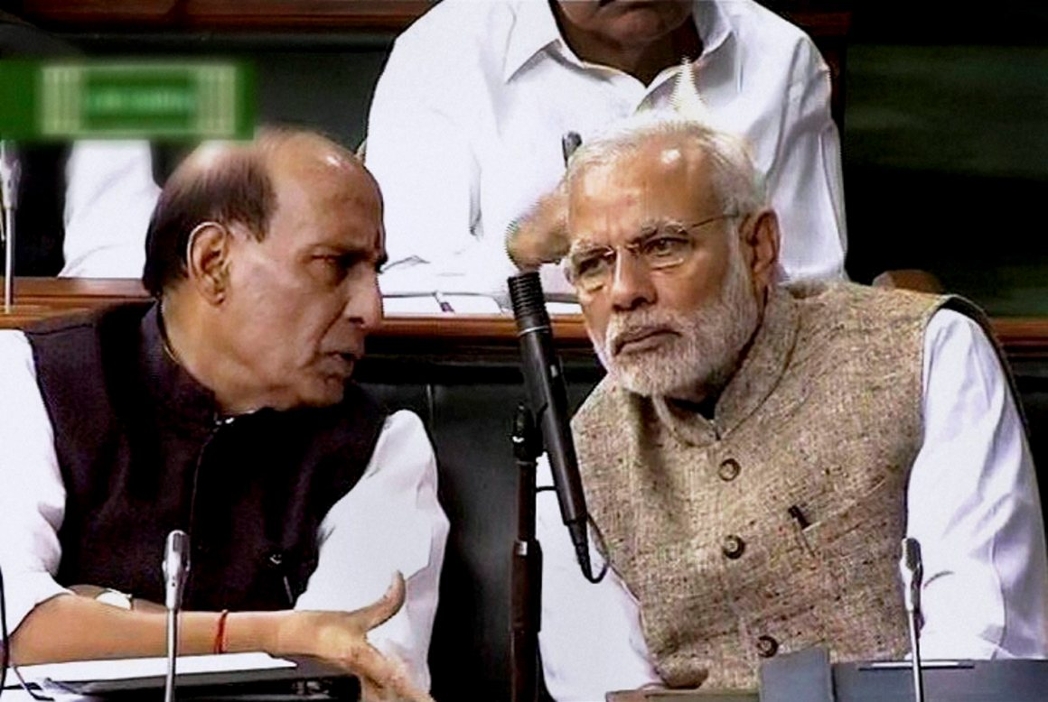 New Delhi: Prime Minister Narendra Modi with Union Home Minister Rajnath Singh in Lok Sabha during the first day of winter session of Parliament in New Delhi on Thursday. PTI Photo / TV GRAB(PTI11_26_2015_000028B)