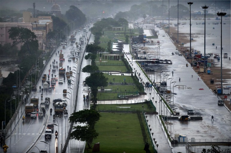 The Marina beach on the Bay of Bengal coast is partly covered with rainwater after heavy rains in Chennai on Tuesday. Normal life has been badly affected due to incessant rains. Credit: PTI