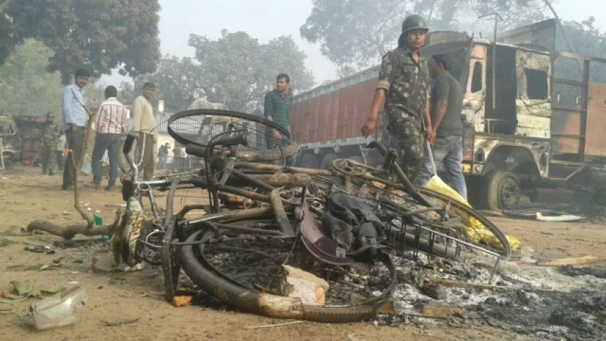 Charred remains of vehicles after violence in Malda, West Bengal. Credit: PTI