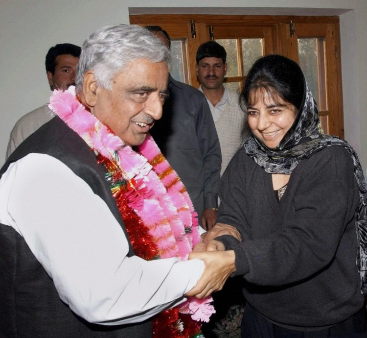 In Her Father's Footsteps: File photo of Mufti Mohammad Sayeed with his daughter Mehbooba Mufti during a meeting in  Srinagar in October 2002. Mufti Mohammad Sayeed passed away at AIIMS in New Delhi on Thursday . Credit: PTI