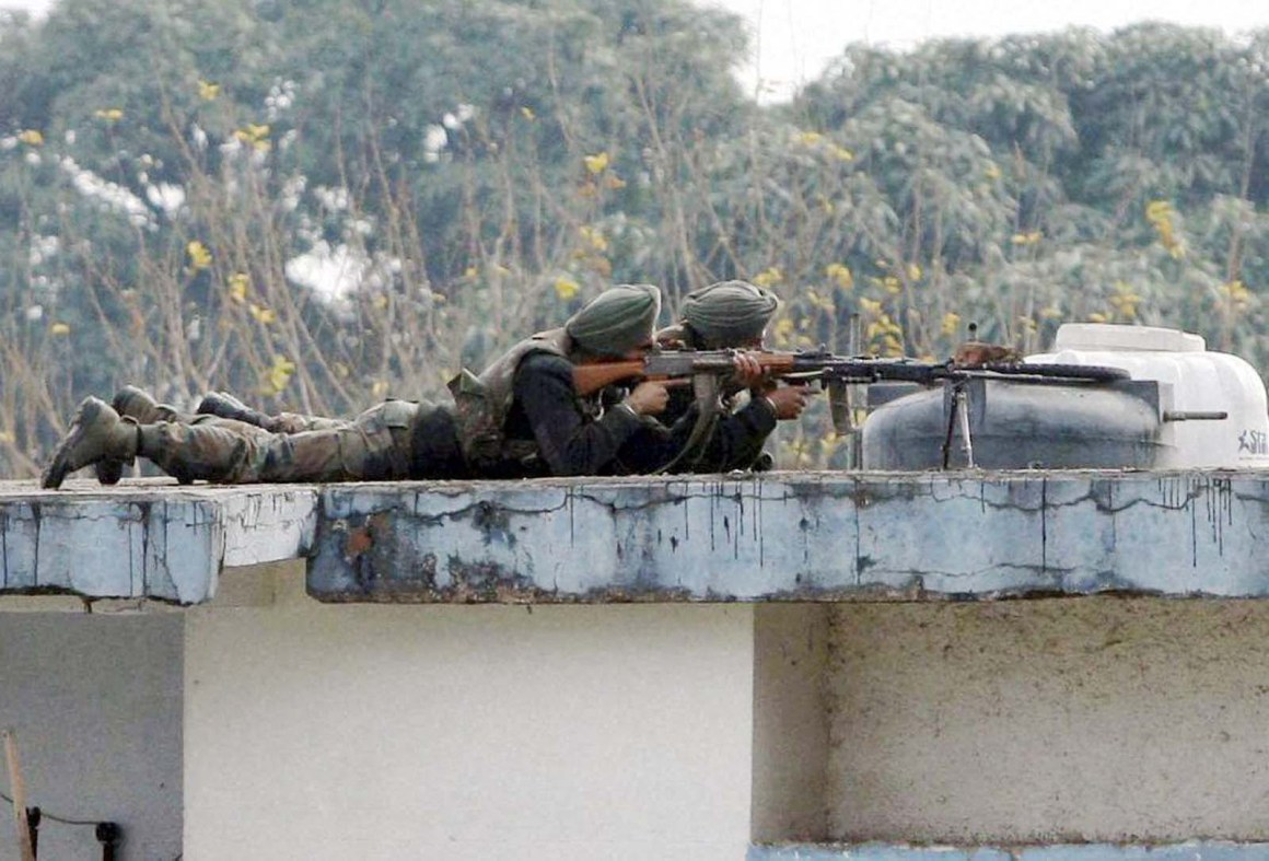 Soldiers on the top of a building at the Indian air force base in Pathankot , a day after the end of military operations against militants. Credit: PTI