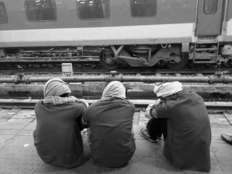 Waiting for Godot: Railway Minister Suresh Prabhu has promised to end all train delays by 2020, though that may be a little late for these gentlemen. Credit: Shome Basu
