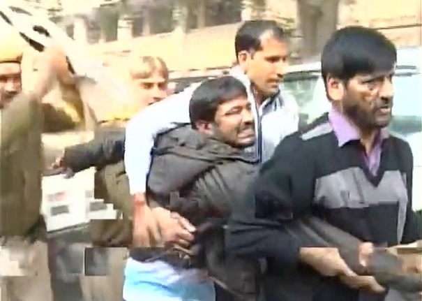 Kanhaiya Kumar was attacked by lawyers while being brought to court. Credit: ANI screengrab.
