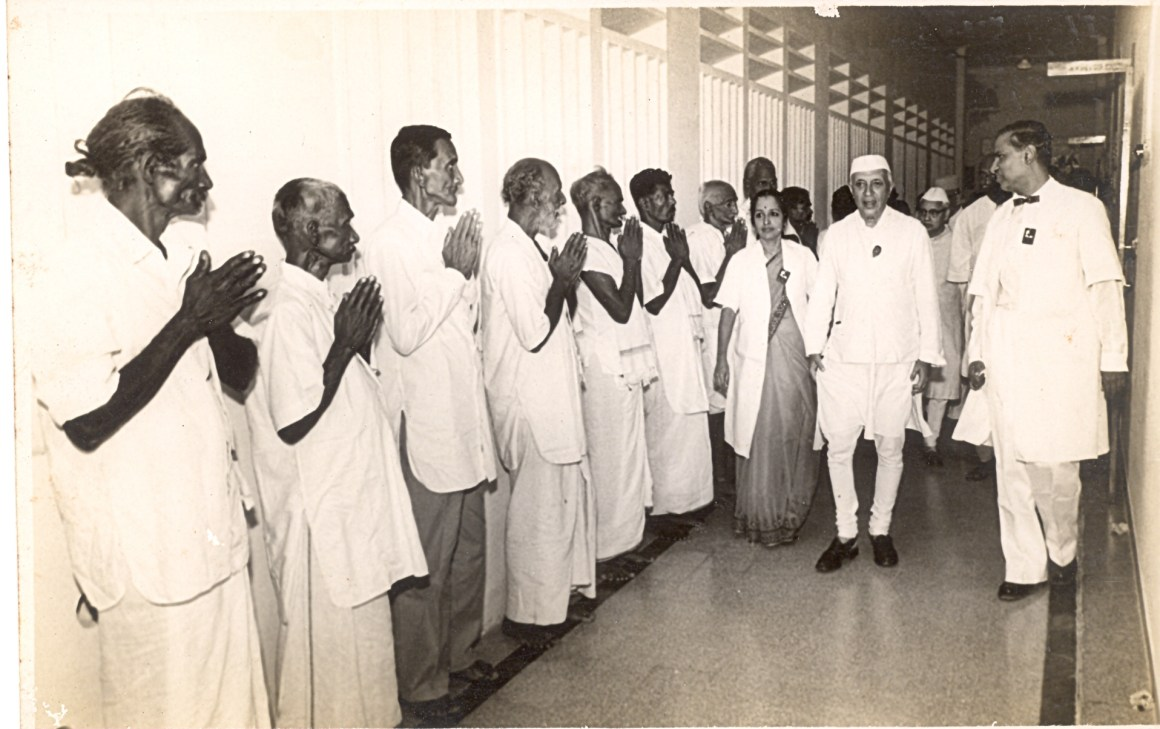 1961 Shanta and Krishnamurthi escort Nehru during Inauguration of McConnel Radiation Wing as he greets a line up of cured patients