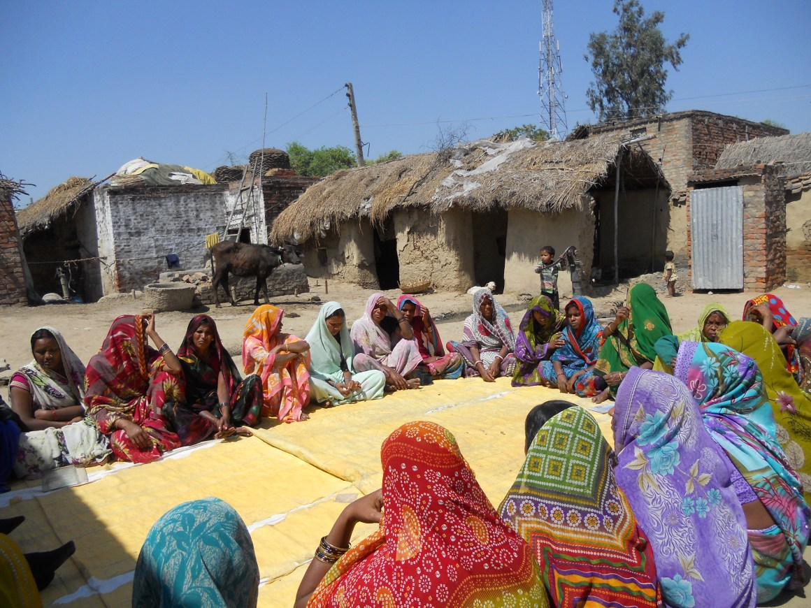 Women at a village near Varanasi attending a microfinance institution meeting. Credit: Special Arrangement