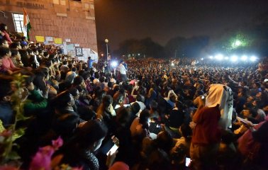 JNU students listen to student union president Kanhaiya Kumar after his release from jail. Credit: PTI
