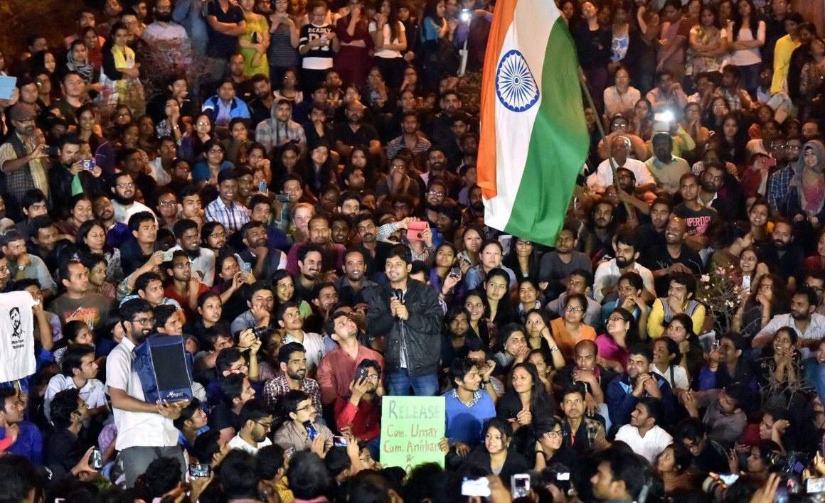 JNUSU President Kanhaiya Kumar addresses students after reaching the JNU campus upon his release on bail, in New Delhi on Thursday. Credit: PTI Photo by Vijay Verma