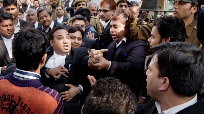 Advocates scuffling at the Delhi High Court where JNU student Kanhaiya Kumar was produced. Credit: PTI