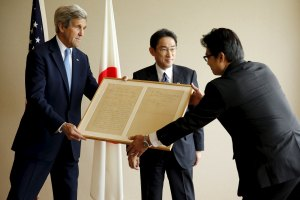 Japan's Foreign Minister Fumio Kishida (centre) presents US Secretary of State John Kerry with a replica of a letter on a friendly diplomatic matter from former US President Abraham Lincoln to the Tycoon of Japan in 1861, before their bilateral meeting alongside the G7 foreign ministers meetings in Hiroshima, Japan, April 11, 2016. Credit: Reuters/Jonathan Ernst