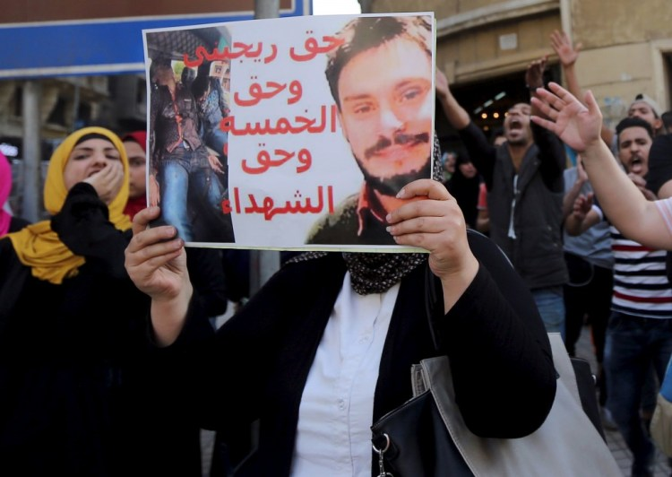 An Egyptian activist holds a poster calling for justice for the recently murdered Italian student Giulio Regeni during a demonstration protesting the government's decision to transfer two Red Sea islands to Saudi Arabia, in front of the Press Syndicate in Cairo, Egypt, April 15, 2016. Credit: Reuters/Mohamed Abd El Ghany