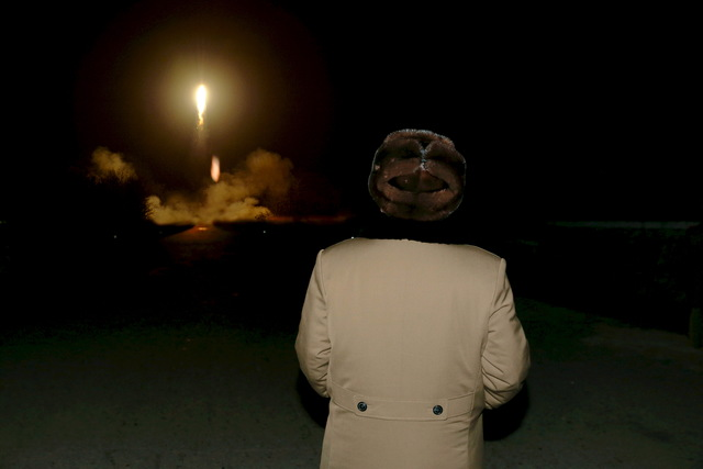 North Korean leader Kim Jong Un watches the ballistic rocket launch drill of the Strategic Force of the Korean People's Army (KPA) at an unknown location, in this undated file photo released by North Korea's Korean Central News Agency (KCNA) in Pyongyang on March 11, 2016. REUTERS/KCNA/Files