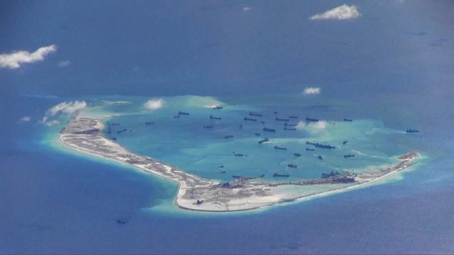 Chinese dredging vessels are purportedly seen in the waters around Mischief Reef in the disputed Spratly Islands in the South China Sea in this still image from video taken by a P-8A Poseidon surveillance aircraft provided by the United States Navy May 21, 2015. Credit: Reuters/US Navy/Handout via Reuters