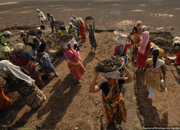 Labourers work on a dried lake to try and revive it under the Mahatma Gandhi National Rural Employment Guarantee Act (MGNREGA) on the outskirts of Hyderabad. Credit: Reuters