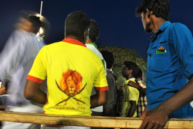 A supporter turns around to show this logo that says Vanniyakula Kshatriyar. Credit: Rohini Mohan