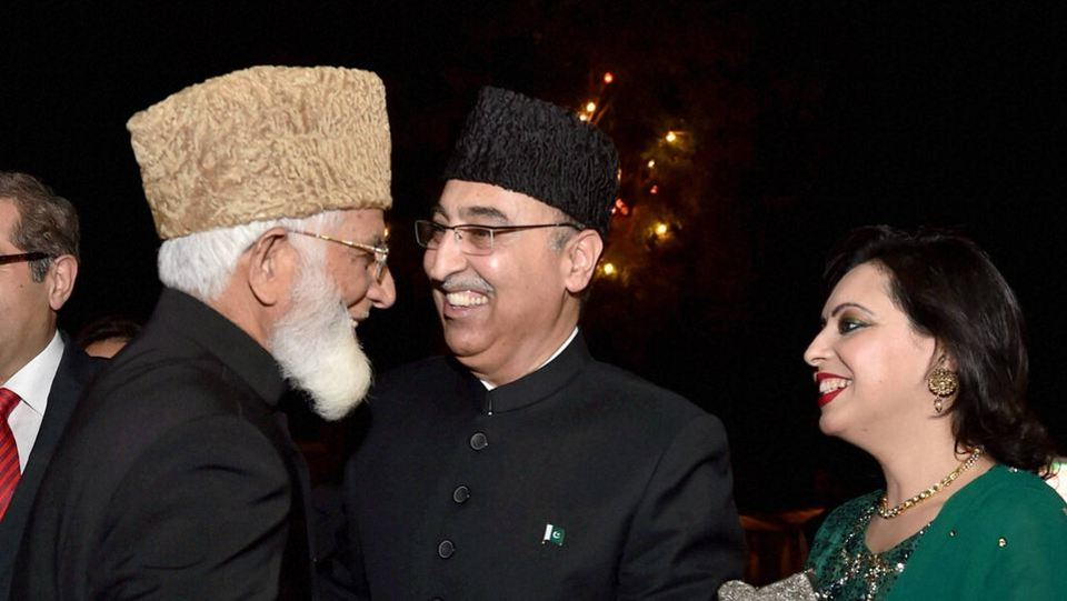 Hurriyat (G) leader Syed Ali Shah Geelani with Pakistani  high commissioner to India Abdul Basit at a recent Pakistan Day event in New Delhi. Credit: PTI