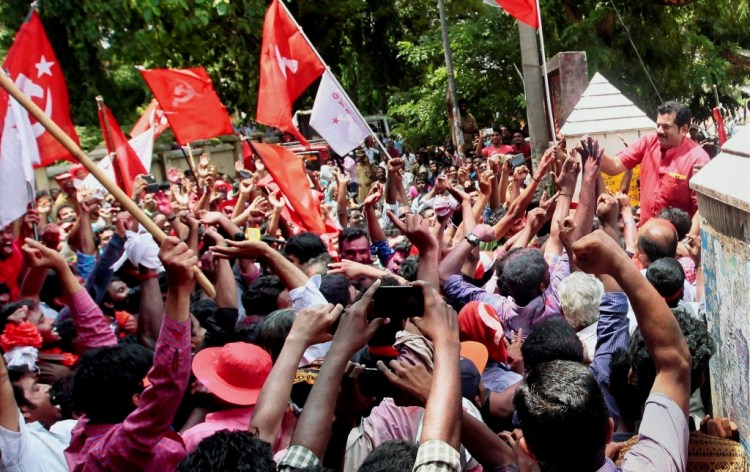 LDF candidate actor Mukesh celebrates with supporters after his win in the Kerala assembly elections in Kollam on Thursday. CreditL PTI