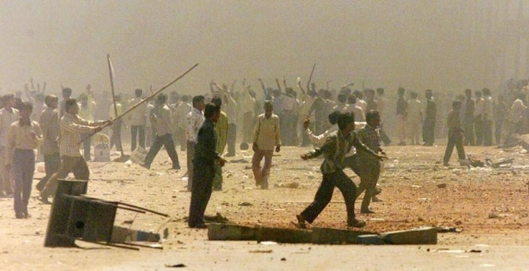 Riots in Ahmedabad, March 1, 2002. Credit: Reuters/Arko Datta/Files
