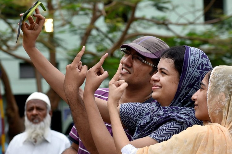 Voters take selfies after casting their ballots for the Tamil Nadu Assembly polls, in Chennai on Monday. Credit: PTI