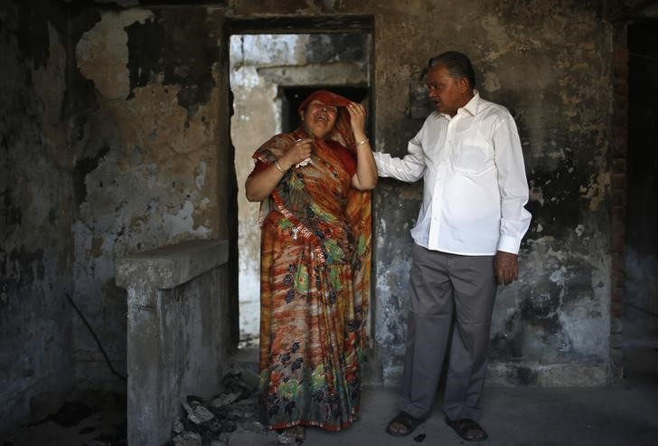 Survivors of the Gulberg Society visit their building. Credit: Reuters/Ahmad Masood/Files