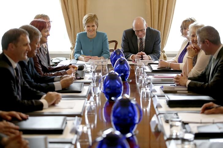 Scotland's First Minister Nicola Sturgeon (centre L) and Deputy First Minister John Swinney (centre R) attend an emergency cabinet meeting at Bute House in Edinburgh, Scotland, June 25, 2016. Credit: Reuters/Jane Barlow/Pool