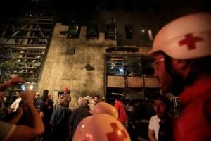 Red Cross members work at the site of an explosion at Blom Bank in Beirut, June 12, 2016. Credit: Reuters/Jamal Saidi