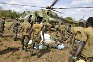 Ugandan soldiers, who are tracking down Lord's Resistance Army (LRA) fugitive leaders, load supplies off a military helicopter in a forest bordering Central African Republic (CAR), South Sudan and Democratic Republic of Congo, near river Chinko April 18, 2012. Credit: Reuters/Stringer/Files