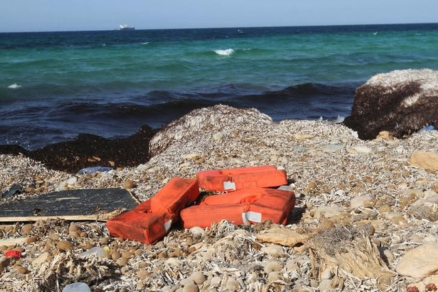 Life jackets washed up on the shore are pictured near a route frequented by migrants trying to cross the Mediterranean, near the coastal town of Zuwara, west of Tripoli, Libya June 4, 2016. Credit: Reuters/Hani Amara