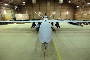 A US Air Force MQ-9 Reaper drone sits armed with Hellfire missiles and a 500-pound bomb in a hanger at Kandahar Airfield, Afghanistan March 9, 2016. Credit: Reuters/Josh Smith/Files
