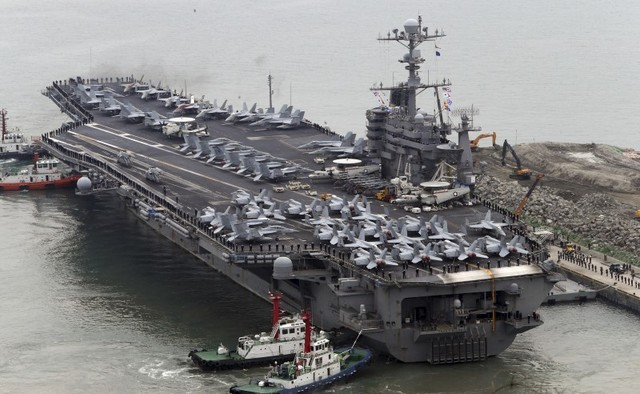 The Nimitz-class aircraft carrier USS John C. Stennis arrives to join the annual Key Resolve military exercise conducted by South Korea and the US, at a port in Busan, South Korea, March 13, 2016. Credit: Reuters/Cho Jung-ho/Yonhap/Files