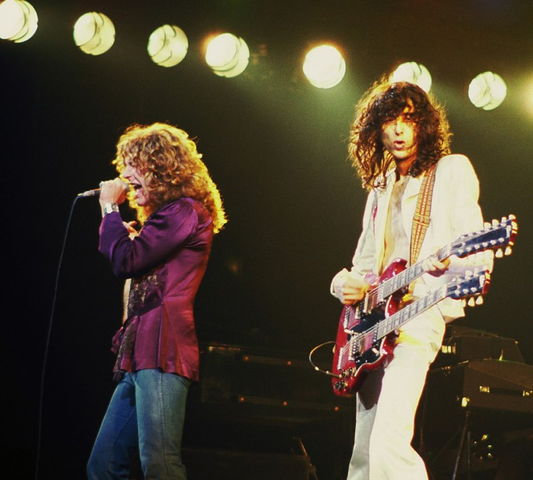 A colour photograph of Led Zeppelin's lead singer Robert Plant and guitarist Jimmy Page. Credit: Wikipedia